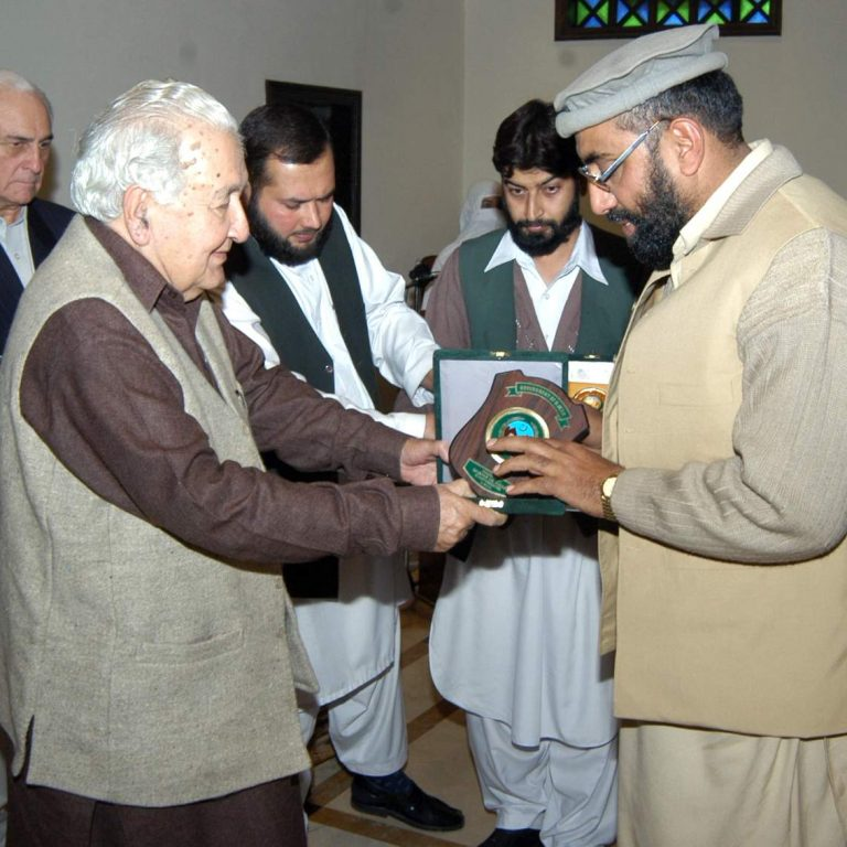 Gul Akbar Receiving Honorary Shield from Mr. Shamsul Mulk, C.M KPK